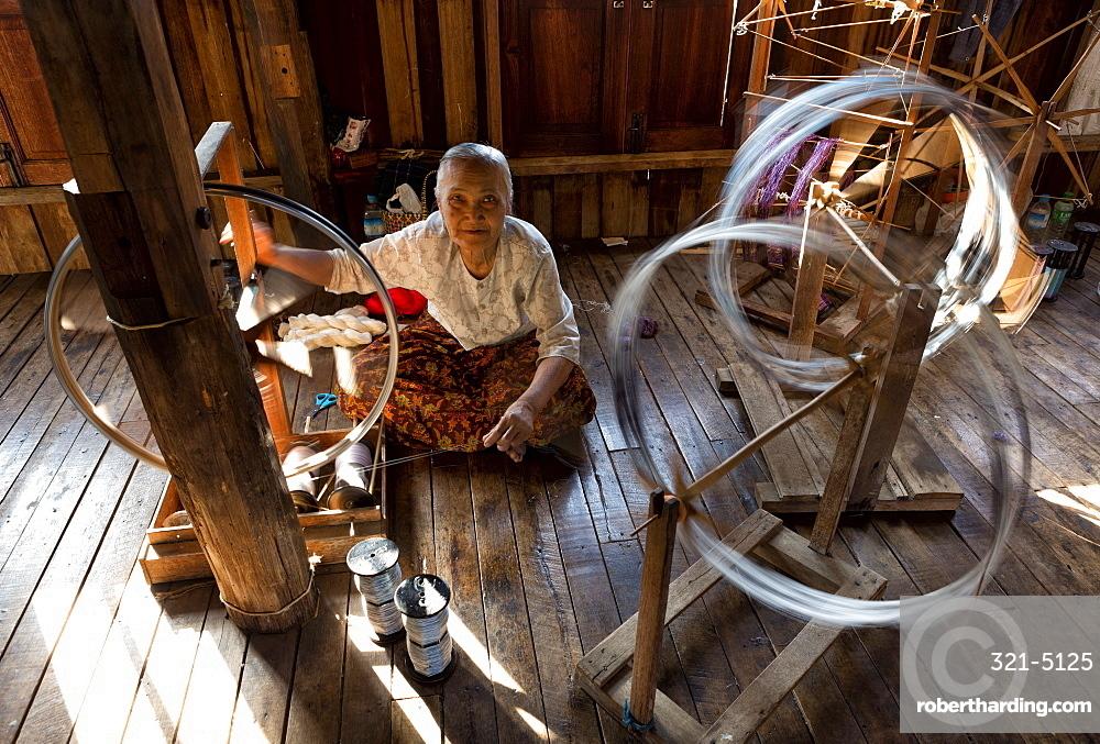 Woman spinning silk in factory in In Phaw Khone village, Inle Lake, Myanmar (Burma), Southeast Asia