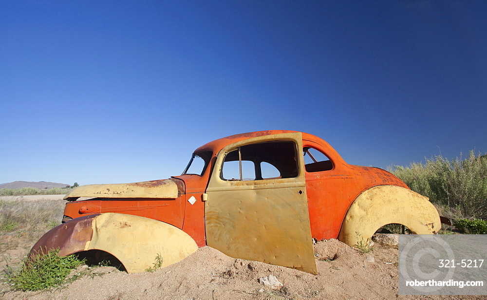 Old abandoned car outside the service station at Solitaire, a lonely outpost near Sesriem, Namib Naukluft Park, Namibia, Africa