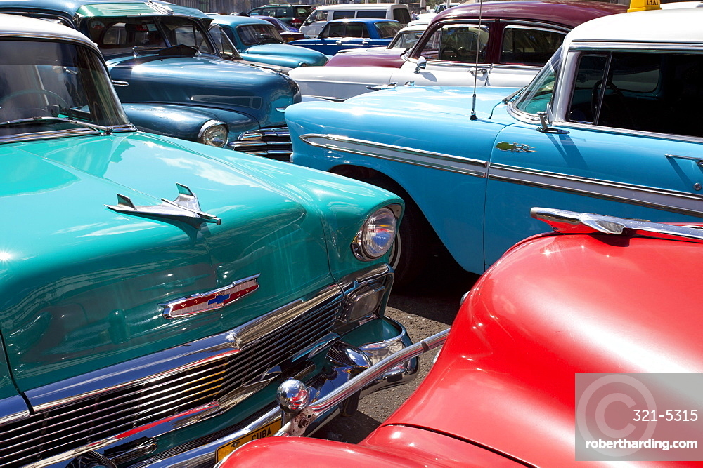 Vintage American cars parked on a street in Havana Centro, Havana, Cuba, West Indies, Central America