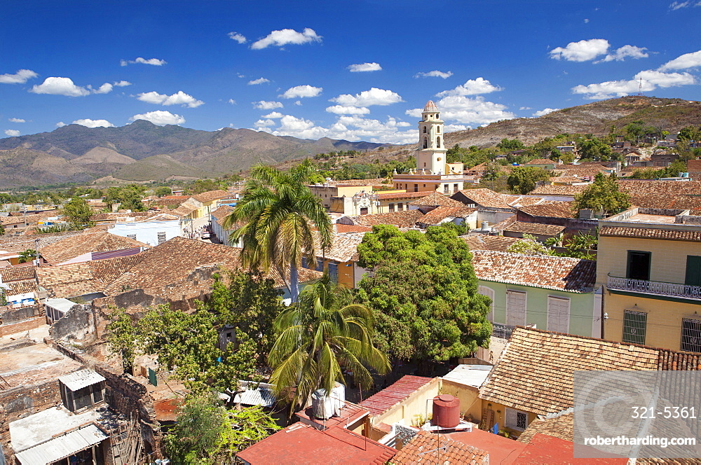 View over pantiled rooftops of the town towards the belltower of The Convento de San Francisco de Asis, Trinidad, UNESCO World Heritage Site, Cuba, West Indies, Central America