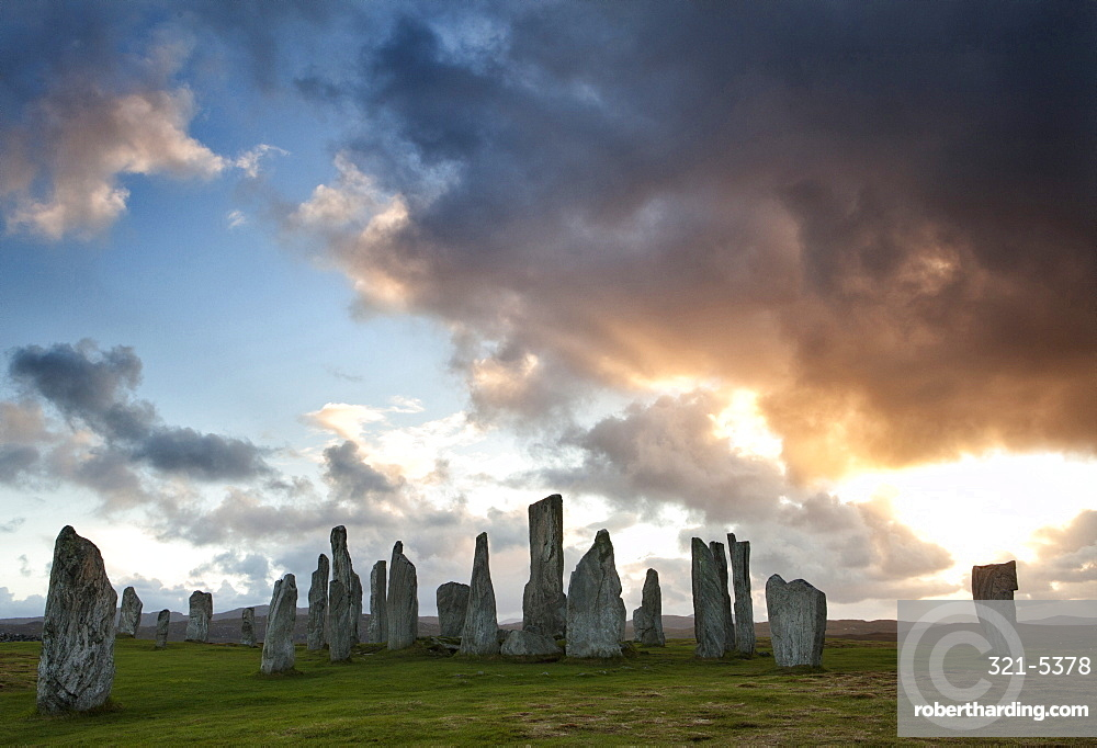 Standing Stones of Callanish at sunset with dramatic sky in the background, near Carloway, Isle of Lewis, Outer Hebrides, Scotland, United Kingdom, Europe