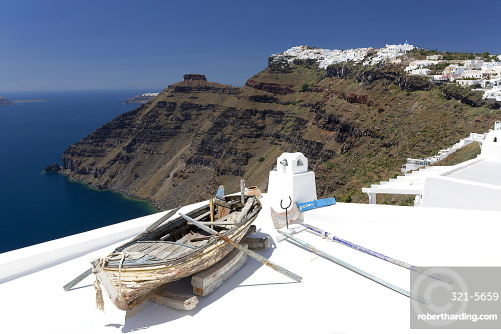 View towards Imerovigli from Firostefani with old rowing boat on hotel roof, Santorini, Cyclades, Greek Islands, Greece, Europe