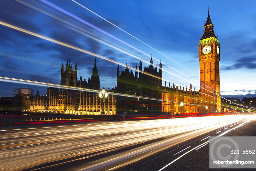 Big Ben and The Houses of Parliament at night with traffic trails on Westminster Bridge, London, England, United Kingdom, Europe