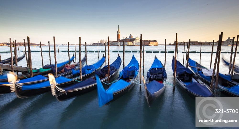 View towards San Giorgio Maggiore from Riva Degli Schiavoni, with gondolas in foreground, Venice, UNESCO World Heritage Site, Veneto, Italy, Europe