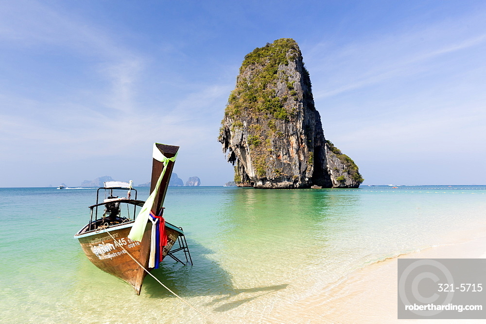 Traditional Longtail boat moored by Phra Nanag Beach with limestone islands in the background, Krabi, Thailand, Southeast Asia, Asia