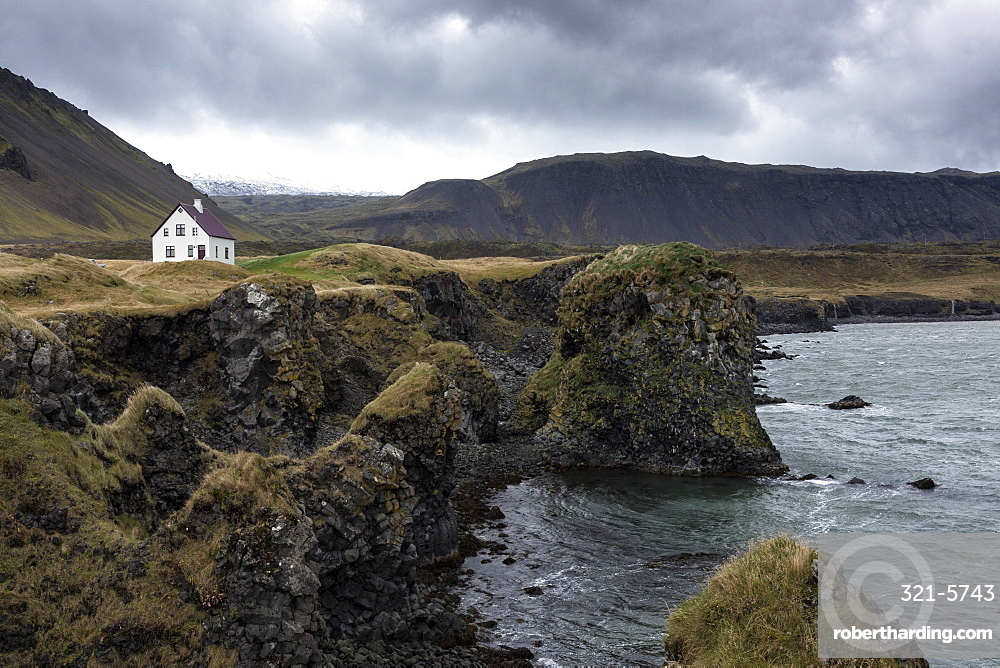 Lone white house among the sea stacks and moutains at Arnastapi, Snaefellsnes Peninsula, Iceland, Polar Regions