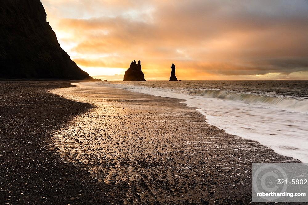 Rock stacks of Reynisdrangar at sunrise, from Halsanefs Hellir Beach near Vik, South Iceland, Polar Regions