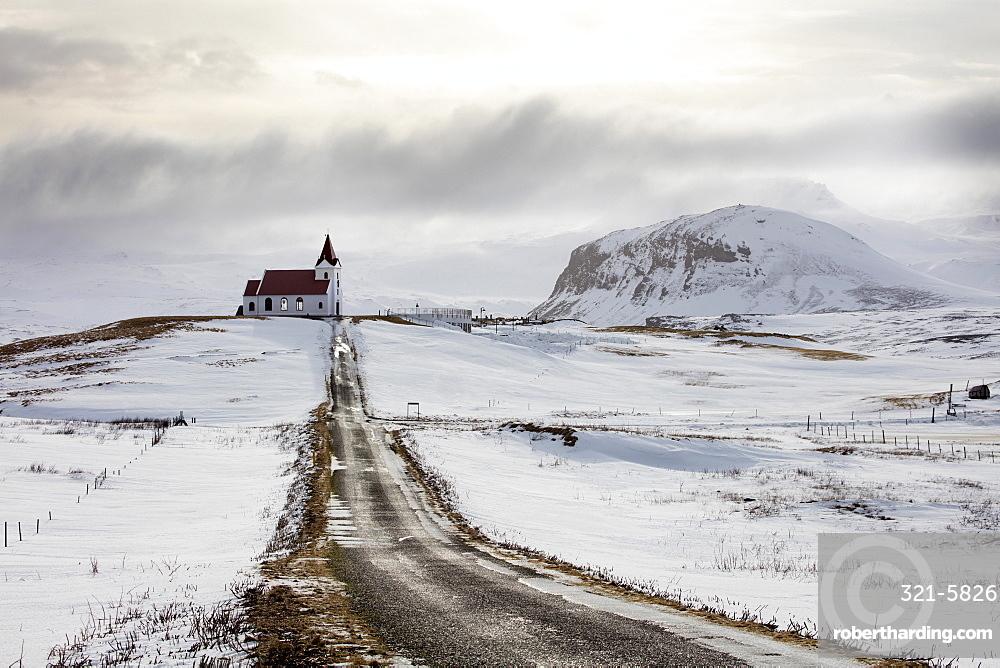 Isolated church (Ingjaldscholskirkja) in winter near Rif on the Snaefellsnes Peninsula, Iceland, Polar Regions