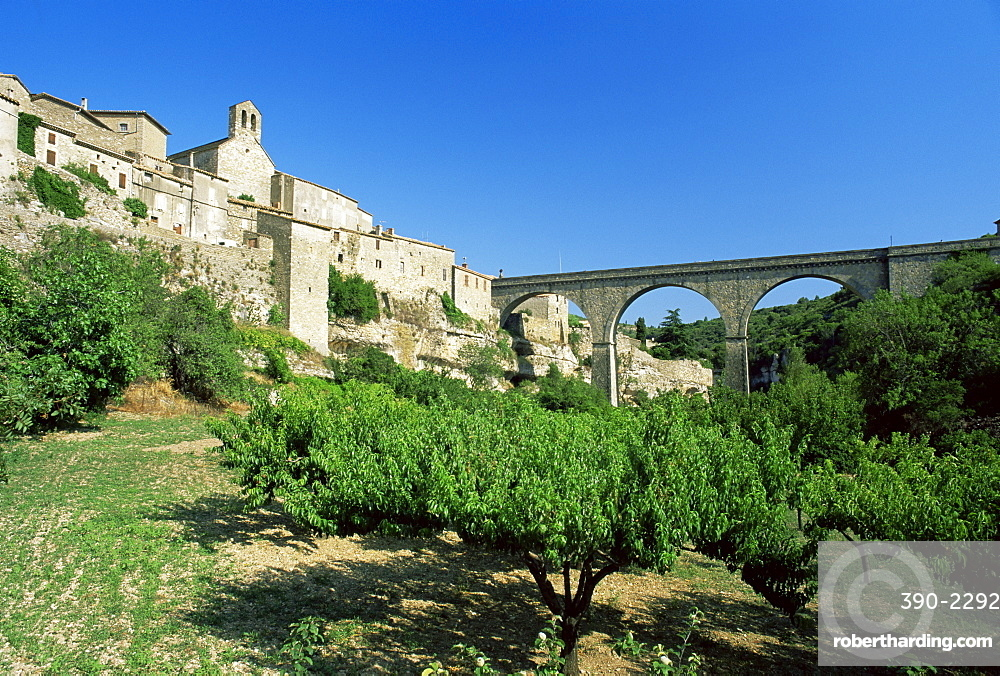 Village seen from floor of the Cesse River canyon, Minerve, Herault, Languedoc-Roussillon, France, Europe