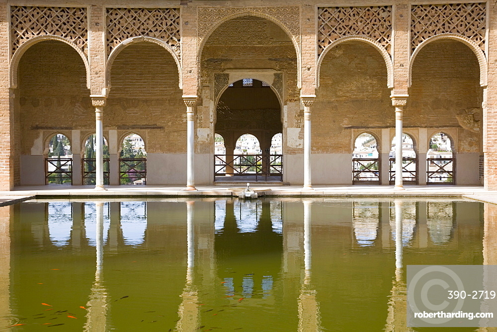 Portico of the Torre de las Damas reflected in tranquil pool, Jardines del Partal, Alhambra, UNESCO World Heritage Site, Granada, Andalucia (Andalusia), Spain, Europe