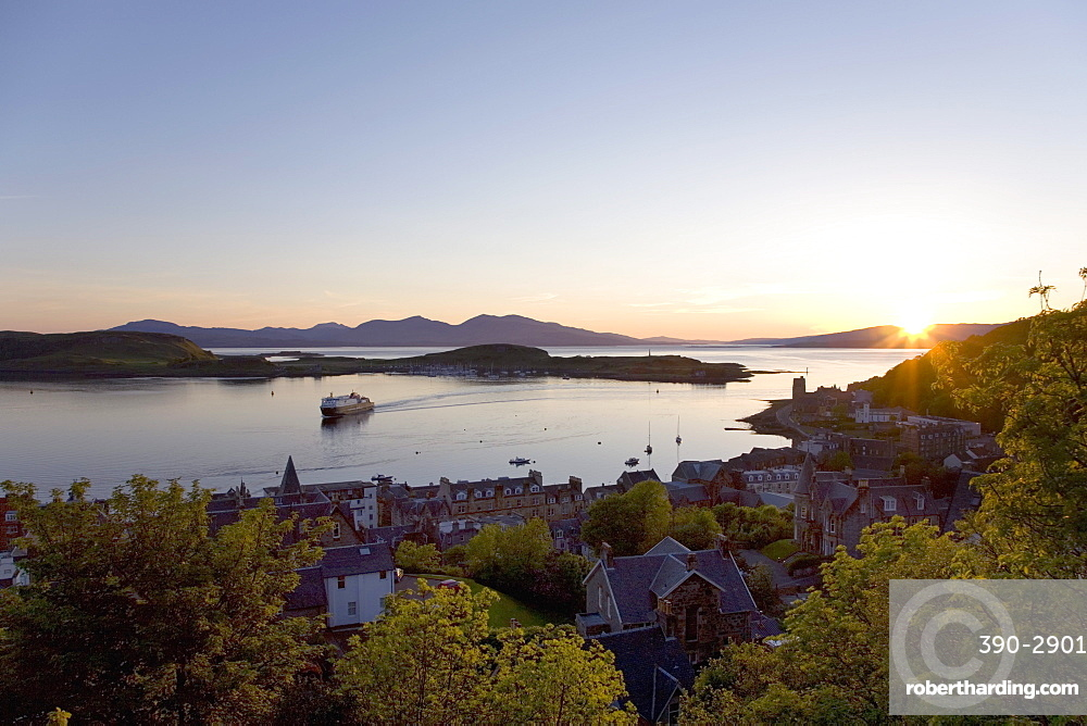 View over Oban Bay from McCaig's Tower, sunset, ferry coming into port, Oban, Argyll and Bute, Scotland, United Kingdom, Europe