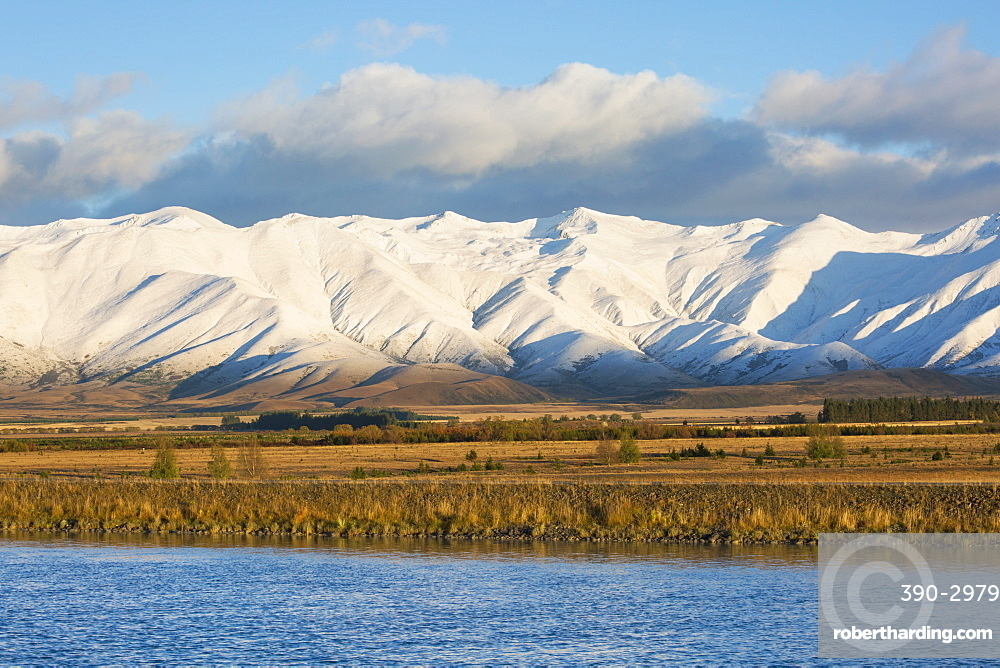 The Ben Ohau Range cloaked in autumn snow, the Pukaki Canal in foreground, Twizel, Mackenzie district, Canterbury, South Island, New Zealand, Pacific