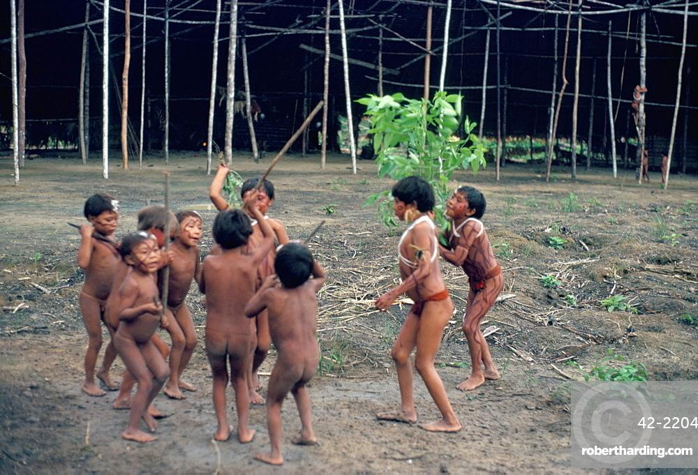 Yanomami children playing inside the yano, Toototobi, Roraima, Brazil, South America