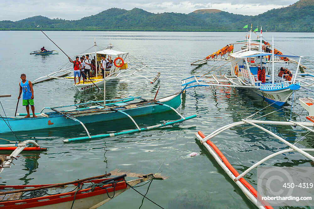 Early morning bangka taxis (outrigger canoes), Coron Harbour, Busuanga island, Philippines, Southeast Asia, Asia