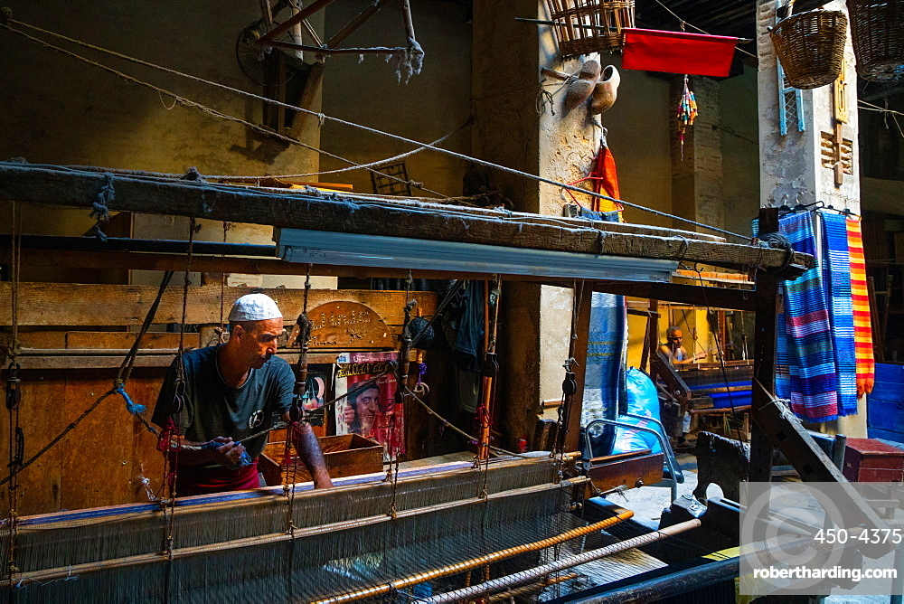 Weaver at work at loom in shop in the Old City (Medina) of Fez, UNESCO World Heritage Site, Morocco, North Africa, Africa