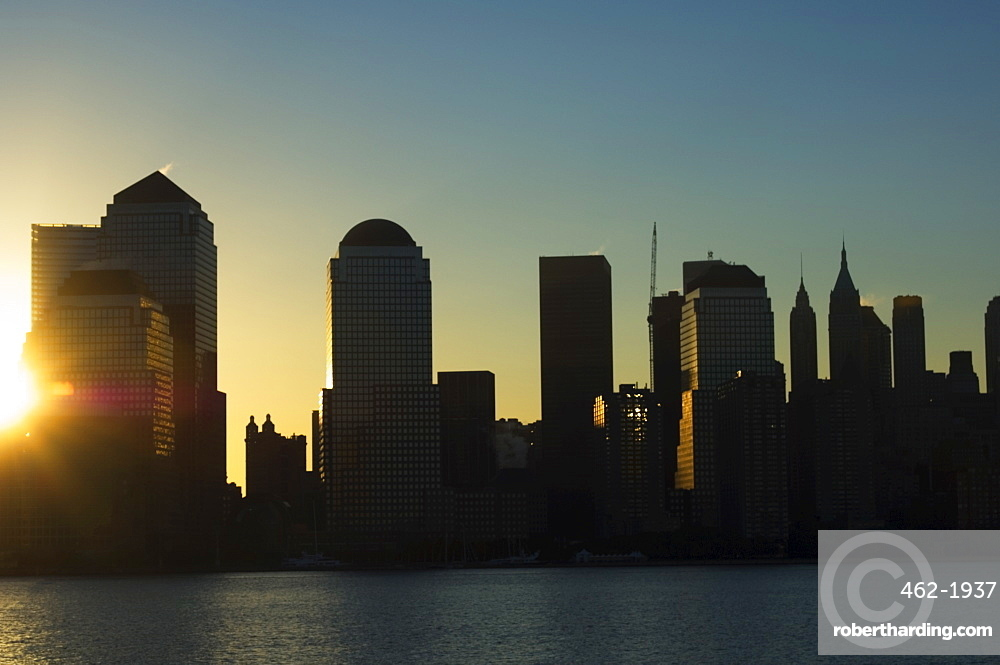 Lower Manhattan skyline at sunrise across the Hudson River, New York City, New York, United States of America, North America