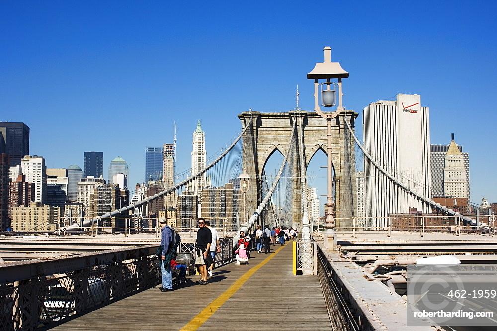 Pedestrian walkway on the Brooklyn Bridge looking towards Manhattan, New York City, New York, United States of America, North America