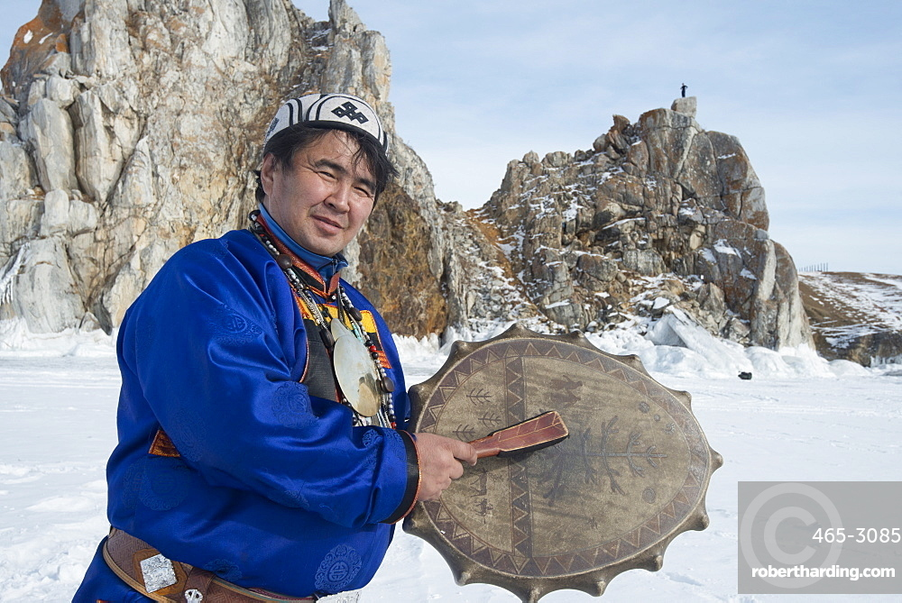 Hereditary Buryat shaman, Valentin Khagdaev with skin covered drum at Olkhon Island celebrating the spirit of Baikal on the ice, Lake Baikal, Irkutsk Oblast, Siberia, Russia, Eurasia