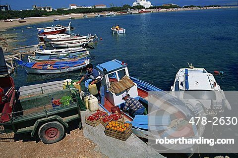 Boxes of tomatoes and oranges on quay as supply boat being unloaded in Scala, Agistri, Saronic Islands, Greek Islands, Greece, Europe