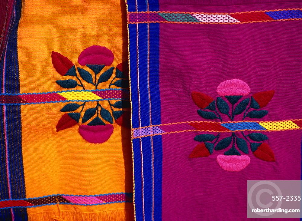 Brightly coloured craft rugs on display at San Cristobal de las Casas, in Chiapas, Mexico, North America