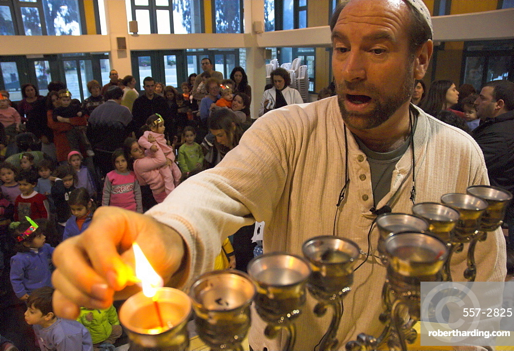 Man lighting first candle for the Hanukkah festival, while saying the benediction, Kol Haneshamah conservative Jewish community, Jerusalem, Israel, Middle East