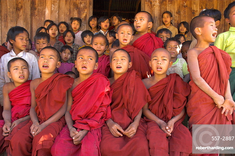 Group of school children, including young monks, singing, village of Thit La, Shan State, Myanmar (Burma), Asia