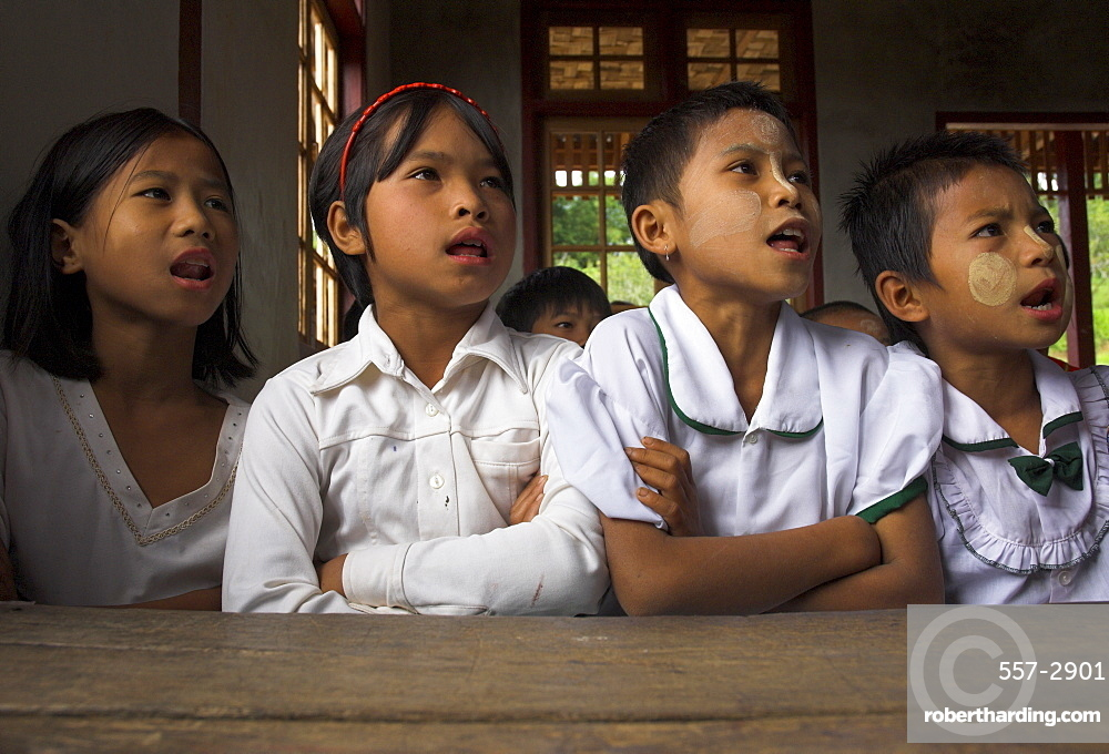 Group of school children reciting lessons in new school building built by local NGO, village of Thit La, Shan State, Myanmar (Burma), Asia