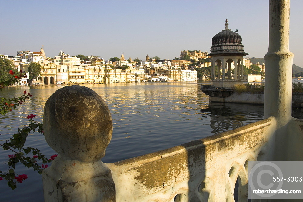 View of old city across Pichola Lake, and decorative lookout tower, Udapiur, Rajasthan state, India, Asia