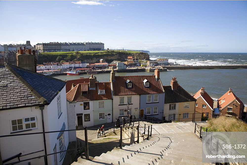 Old Town and River Esk harbour from steps on East Cliff, with West Cliff beyond, Whitby, Heritage Coast of North East England, North Yorkshire, England, United Kingdom, Europe