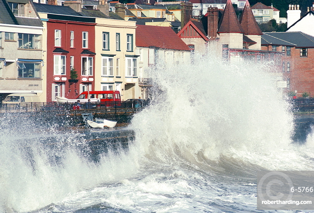 Waves pounding sea wall and rail track in storm, Dawlish, Devon, England, United Kingdom, Europe