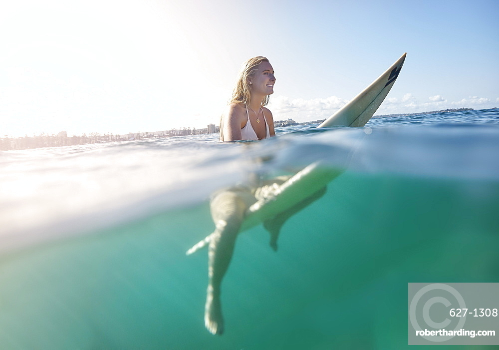 Girl on surfboard, New South Wales, Australia, Pacific