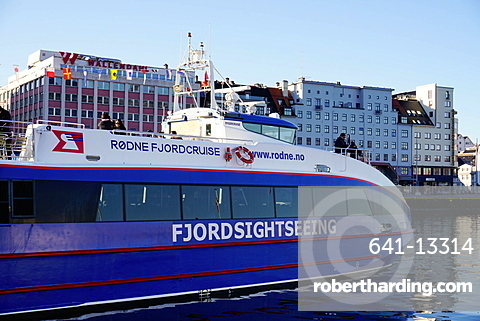 View on the harbour with tourist boat for touring Fjords, Bergen, Hordaland, Norway, Scandinavia, Europe
