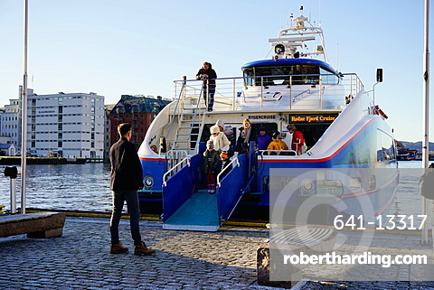 Passengers disembarking from tourist boat for touring Fjords, Bergen, Hordaland, Norway, Scandinavia, Europe
