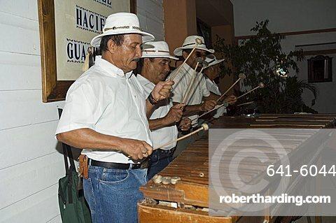Musicians playing a type of xylophone, Hacienda Guachipelin, near Rincon de la Vieja National Park, Guanacaste, Costa Rica, Central America