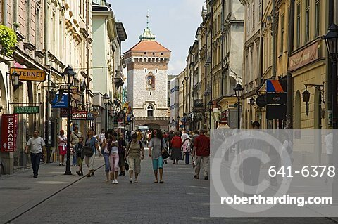 Looking down Florianska street towards the Barbican and Florian's Gate on the old city walls, UNESCO World Heritage Site, Krakow (Cracow), Poland, Europe