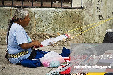 Weaving on street, Oaxaca City, Oaxaca, Mexico, North America