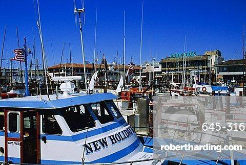 Fleet of small fishing boats around Pier 39, Fisherman's  Wharf, San Francisco, California, USA
