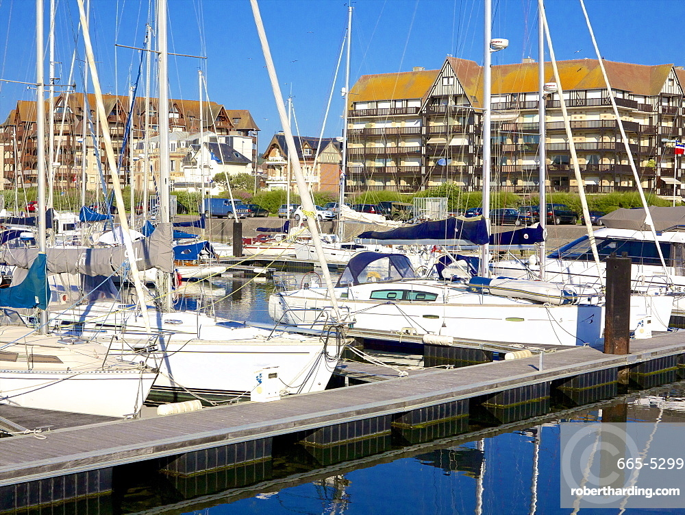 Floating quay and pleasure boats, with contemporary flats in Norman style in the background, Port Deauville, Deauville, Calvados, Normandy, France, Europe