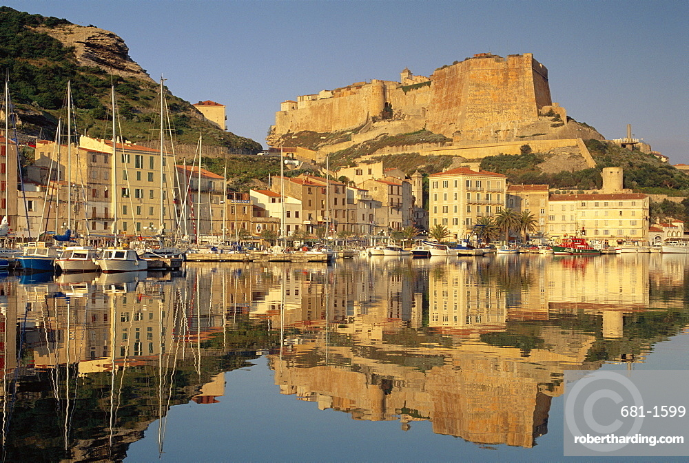 Yachts moored in the harbour, with the citadel behind, Bonifacio, Corsica, (France)