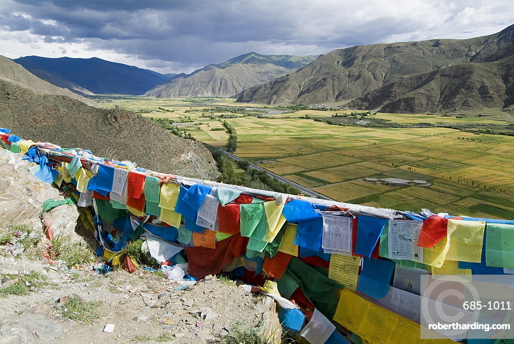 Prayer flags and view over cultivated fields, Yumbulagung Castle, Tibet, China, Asia