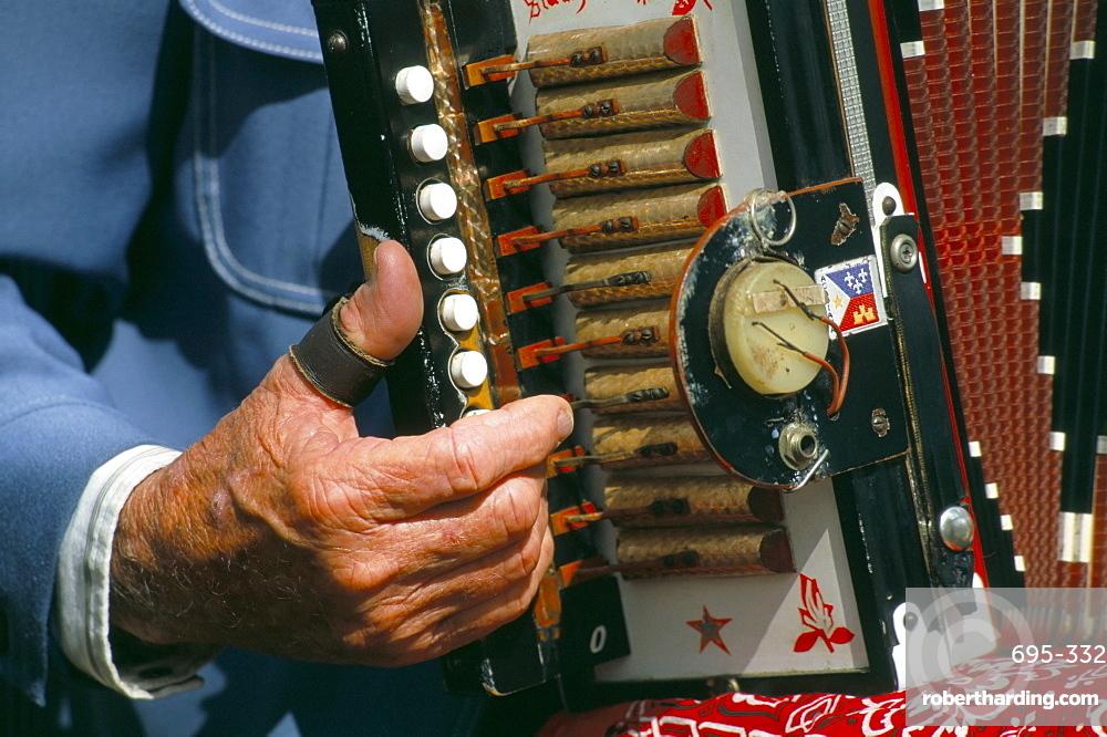 Close-up of man playing accordian