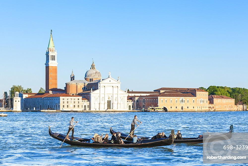 Venetian gondolas with tourists opposite the Island of San Giorgio Maggiore, on the Canale di San Marco, Venice, UNESCO World Heritage Site, Veneto, Italy, Europe