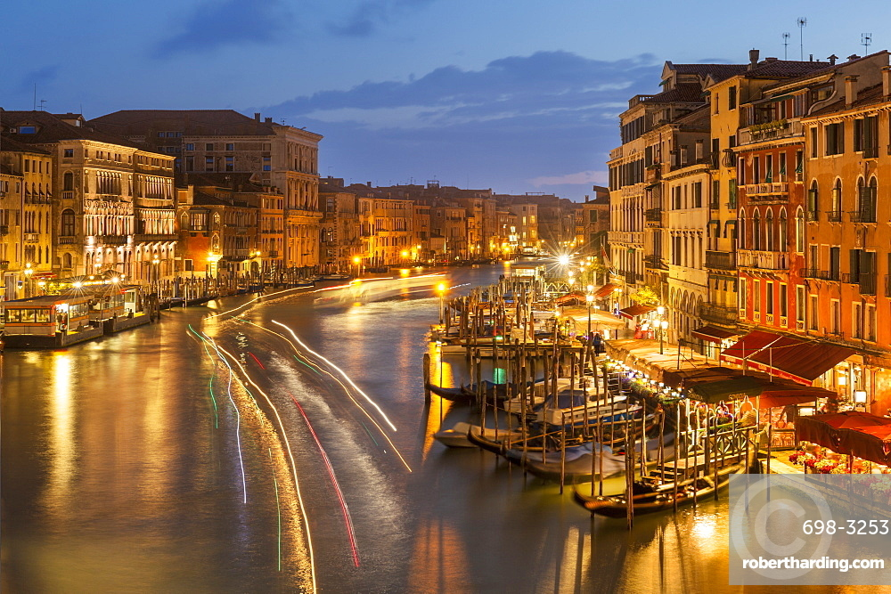 Grand Canal at night with boat light trails and moored gondolas, on the Fondementa del Vin, UNESCO World Heritage Site, Venice, Veneto, Italy, Europe