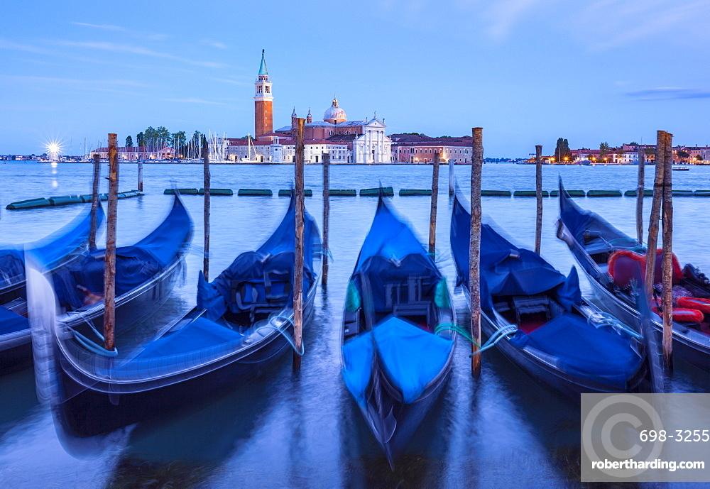Gondolas moored at night in the Bacino di San Marco (St. Mark's Basin), waterfront, Venice, UNESCO World Heritage Site, Veneto, Italy, Europe