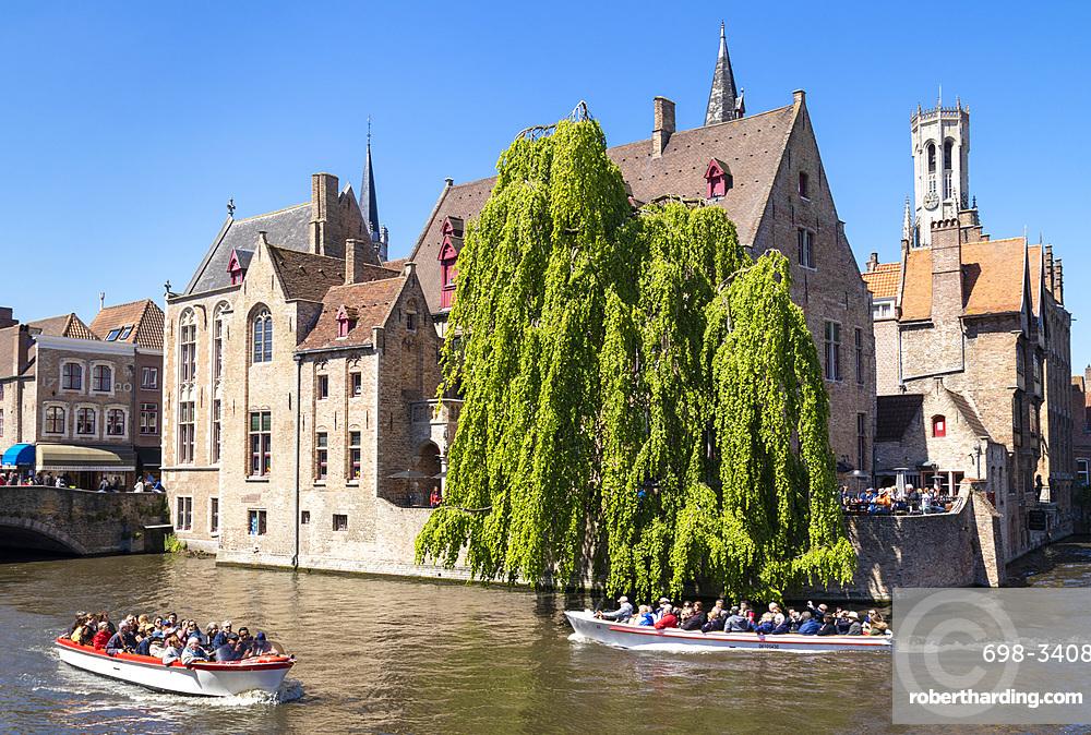 Bruges Belfry and tourist boats on Den Dijver Bruges Canal, Bruges, UNESCO World Heritage Site, West Flanders, Belgium, Europe