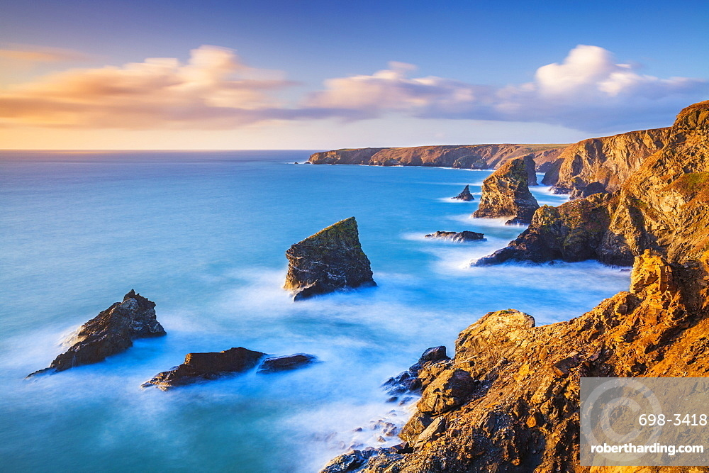 Sunset, Bedruthan steps sea stacks at high tide, Carnewas, Bedruthan, North Cornwall coast, Cornwall, England, United Kingdom, Europe
