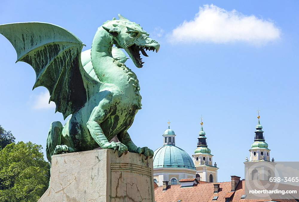 Dragon statue on the Dragon Bridge (Zmajski most) in front of the Ljubljana Cathedral, Ljubljana, Slovenia, Europe