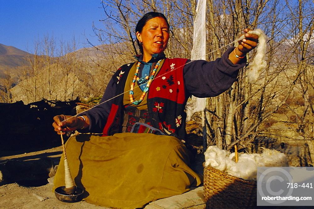 Gurung woman spinning wool, near MUKtinath, Nepal