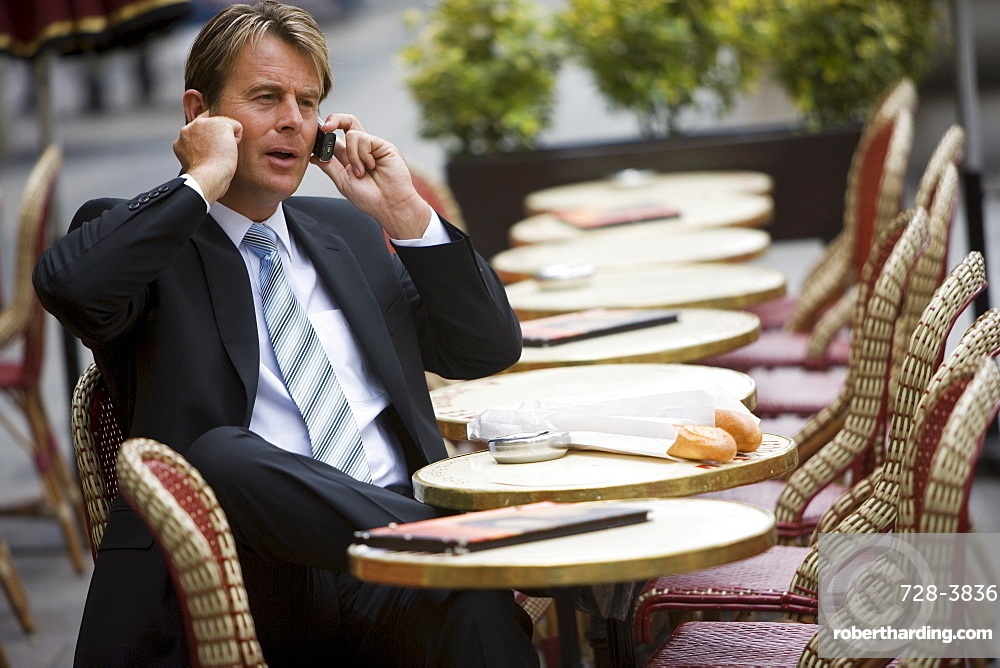 Business man in cafe, Paris, France, Europe