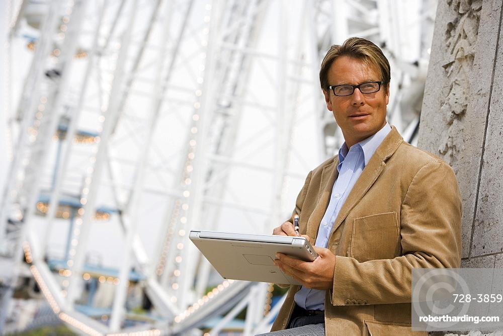 Professional man at a fairground, Paris, France, Europe